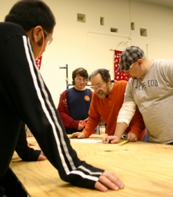 Adults, alumni, and students working together